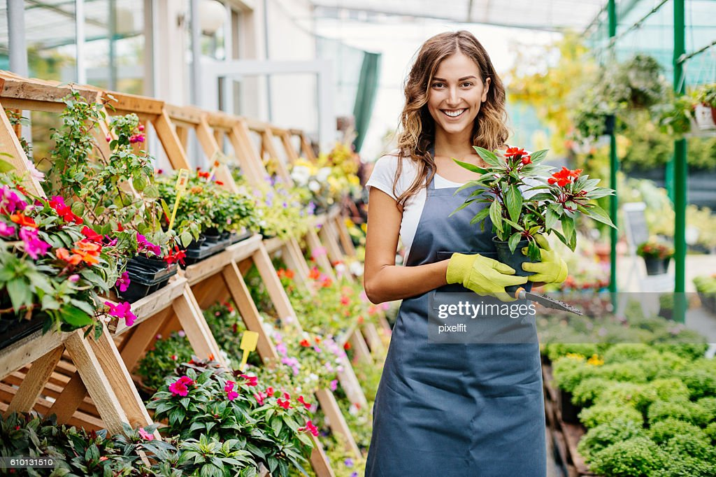 Smiling young gardener : Stock Photo