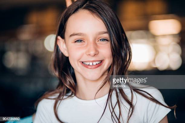 smiling young girl - pre adolescent child stock pictures, royalty-free photos & images