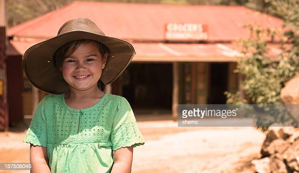 Smiling young girl wearing a hat in Australian Outback
