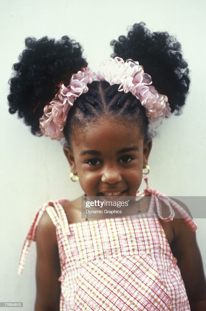 Remarkable Smiling Young Girl With Afro Puffs Curacao High Res Stock Photo Natural Hairstyles Runnerswayorg
