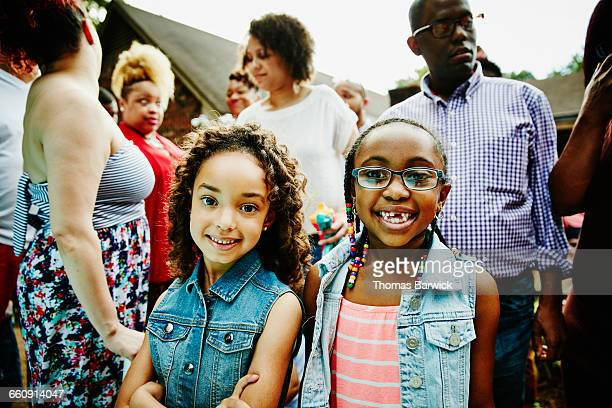 Smiling young girls at backyard party