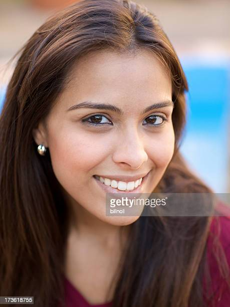 smiling young hispanic woman near swimming pool - beautiful mexican girls stock photos and pictures