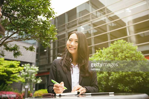 Smiling young Japanese business woman
