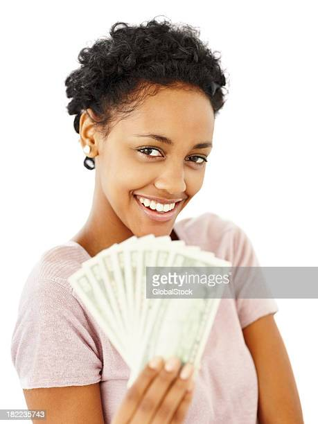 Smiling young lady holding currency notes