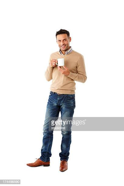 Smiling young man having a cup of coffee