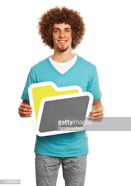 Smiling young man holding folder sign isolated on white background.