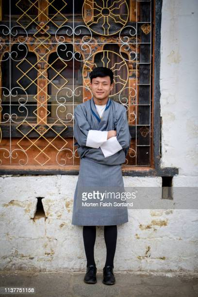 a smiling young man in thimphu, bhutan - thimphu stock pictures, royalty-free photos & images