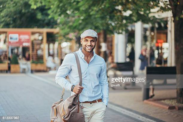 Smiling young man on the street