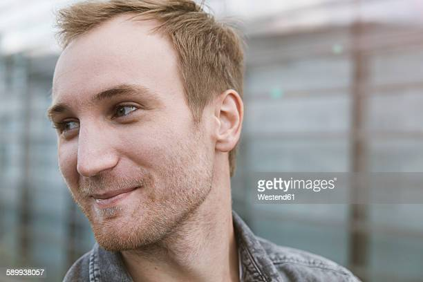 Smiling young man outdoors