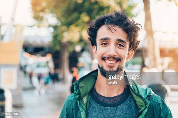 smiling young man - young men stock pictures, royalty-free photos & images
