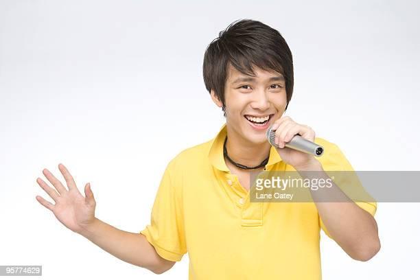 Smiling young man singing songs