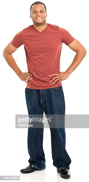 smiling young man standing with hands on hips - red pants stock photos and pictures