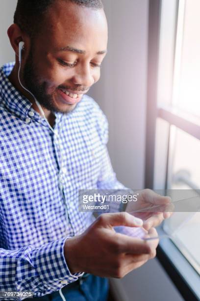 Smiling young man using a futuristic tablet