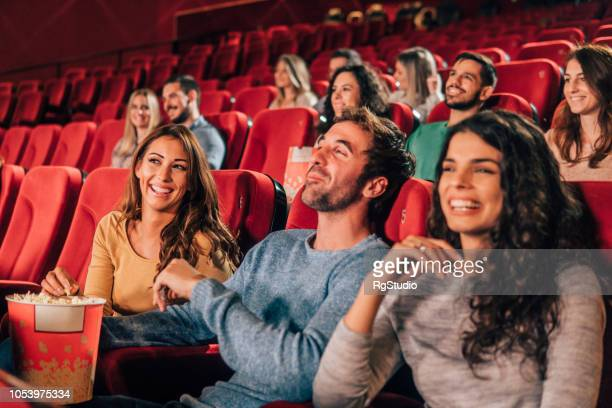 smiling young people at cinema - film screening stock pictures, royalty-free photos & images