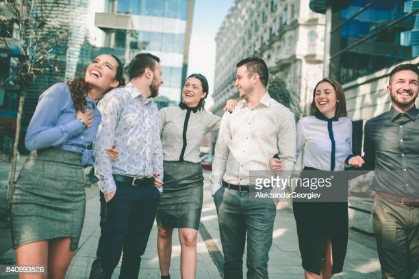 smiling young students walking on the street and talking - aleksandar georgiev stock photos and pictures