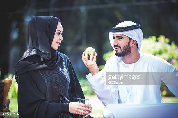 Smiling Young UAE couple in a park