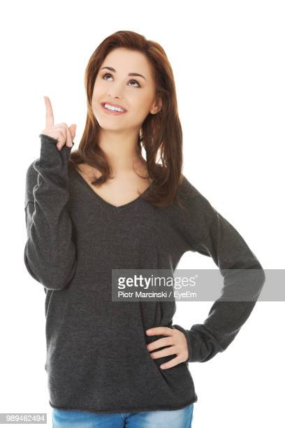 Smiling Young Woman Against White Background
