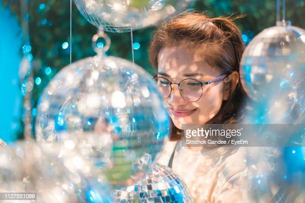 Smiling Young Woman Amidst Christmas Decoration