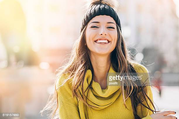 smiling young woman at sunlight - beauty in nature stock pictures, royalty-free photos & images