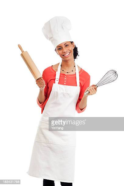 Smiling Young Woman Chef with Apron, Hat, and Kitchen Utensils
