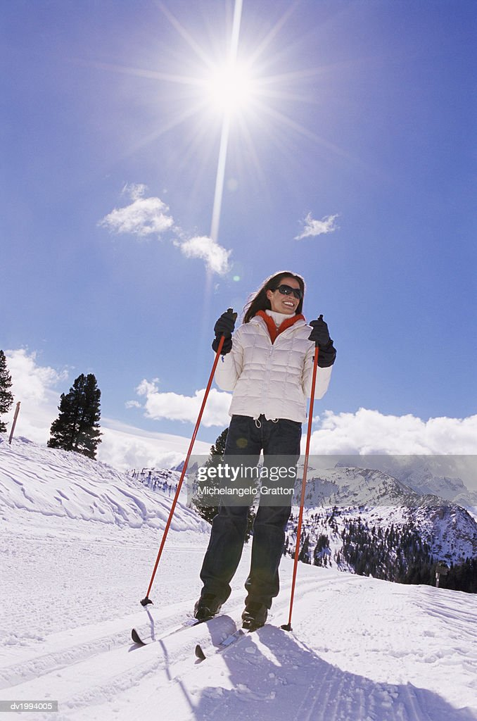 Smiling, Young Woman Cross Country Skiing : Stock Photo