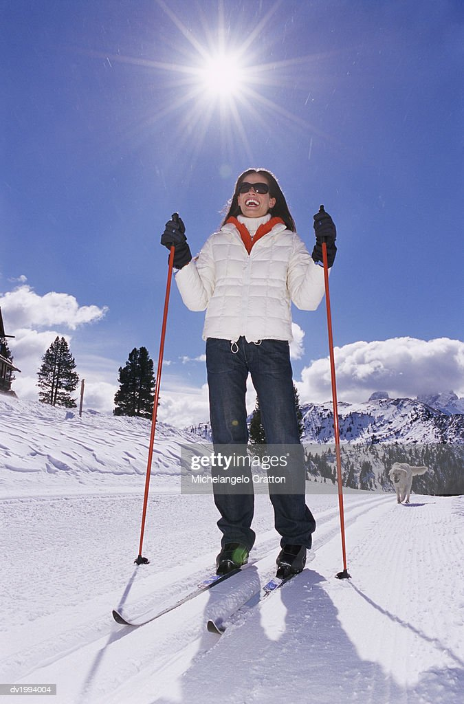 Smiling, Young Woman Cross Country Skiing With Her Pet Dog : Stock Photo