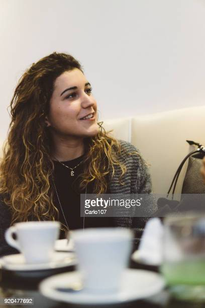 Smiling young woman during a coffee break
