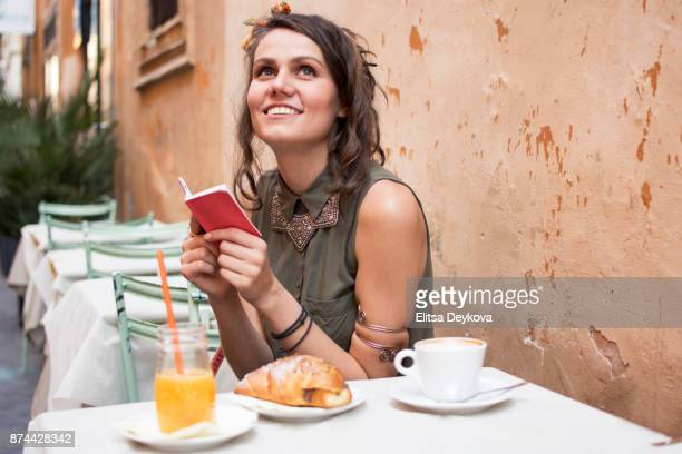 smiling young woman early in the morning - poet stock pictures, royalty-free photos & images