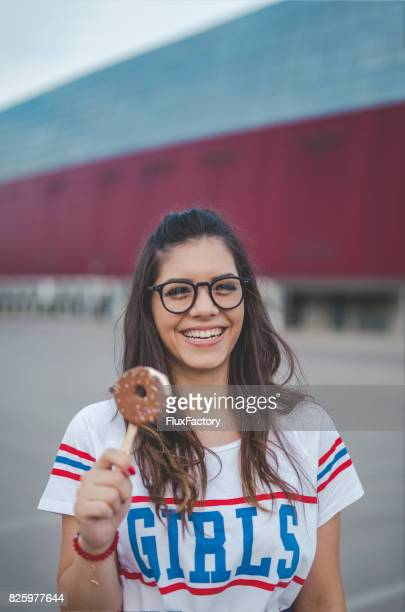 Smiling young woman holding an ice cream