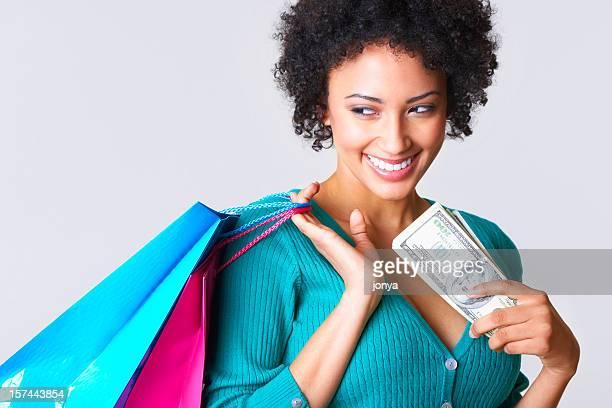 笑顔若い女性の愛をお金、持ち運び用ショッピングバッグ