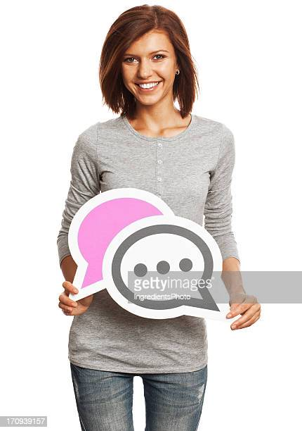 Smiling young woman holding chat sign isolated on white background.