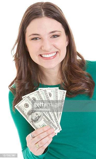 Smiling young woman holding fanned out money notes