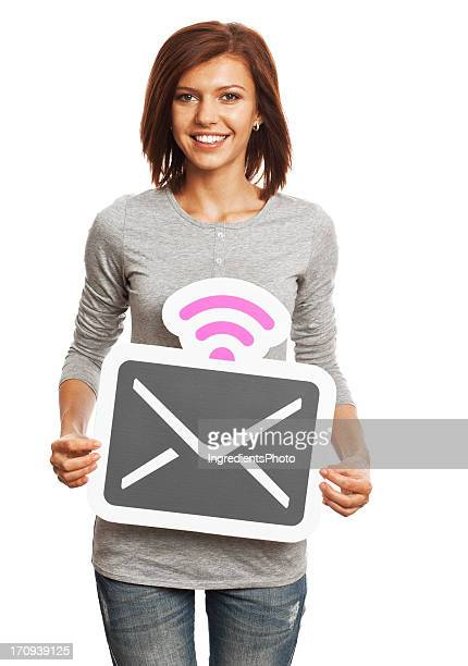 Smiling young woman holding mail sign isolated on white background.