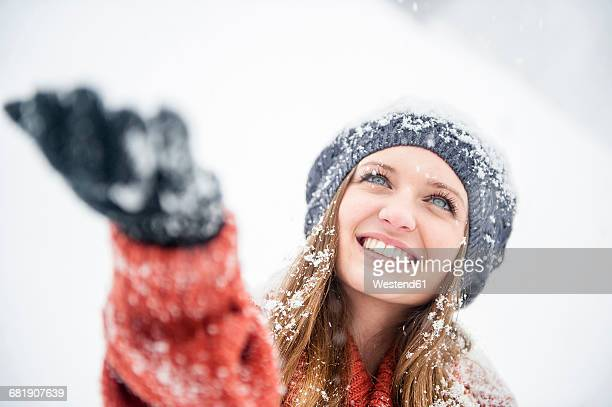 Smiling young woman in heavy snowfall