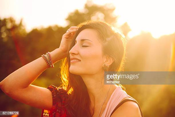 Smiling young woman in the magic hour