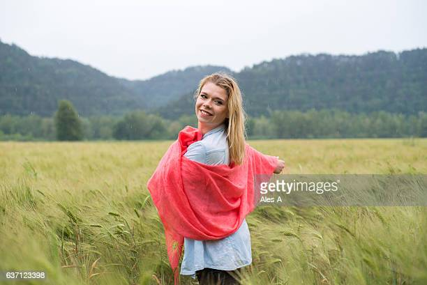 smiling young woman in wheat field - shawl stock pictures, royalty-free photos & images