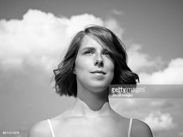 smiling young woman looking away - norrkoping fotografías e imágenes de stock