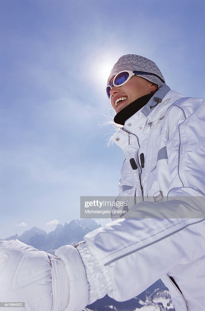 Smiling, Young Woman on a Skiing Holiday in the Mountains : Stock Photo