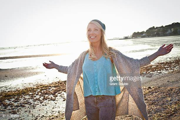 Smiling young woman on Bournemouth beach, Dorset, UK