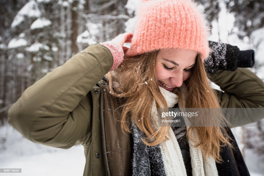 Smiling young woman outdoors in winter : Stock Photo