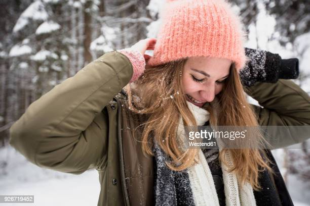 Smiling young woman outdoors in winter