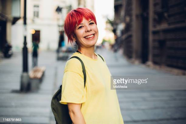 smiling young woman - dyed red hair stock pictures, royalty-free photos & images