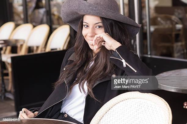 smiling young woman sitting at a sidewalk cafe. - jean marc payet stock pictures, royalty-free photos & images