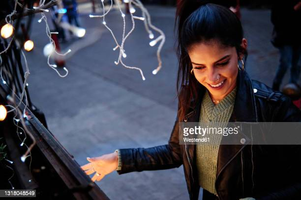 smiling young woman spending leisure time in city - embellished jacket stock pictures, royalty-free photos & images