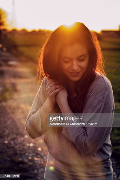 Smiling Young Woman Standing On Road