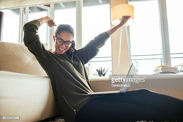 smiling young woman stretching and relaxing from work