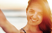 closeup young woman smiling taking selfie