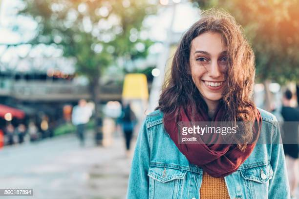 Smiling young woman walking on the street