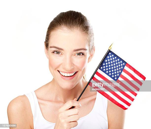 Smiling young woman with American flag