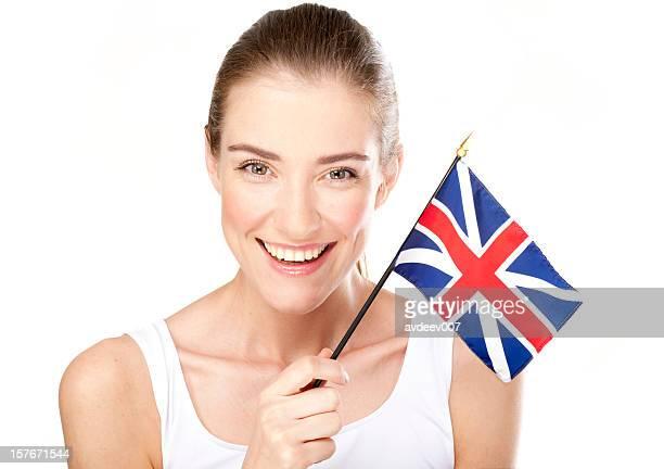 Sonriente Joven mujer con bandera británica